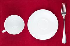 Cup, plate and fork Royalty Free Stock Photography