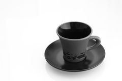 Cup with plate. Grey cup on black plate isolated on white background royalty free stock photography