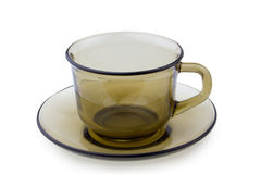Cup on plate isolated Stock Images