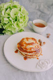 A cup and a plate of pancakes, hydrangea Royalty Free Stock Photo