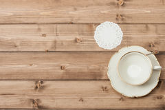 Cup And Plate. Wooden Background With Copy Space Stock Photos