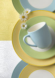 Cup and plates Royalty Free Stock Photography