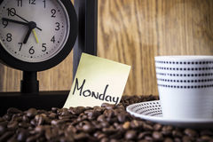 Cup polka dots, clock and a sticker with the day Stock Image