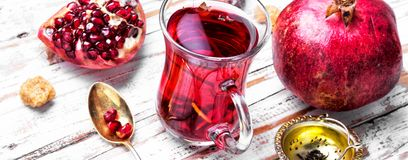 Cup of pomegranate tea royalty free stock photo