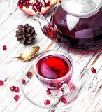 Cup of pomegranate tea royalty free stock image