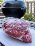 `Cup` Pork cut in preparation. For baking barbecue on pulled pork, in the background barbecue in the garden Stock Photos