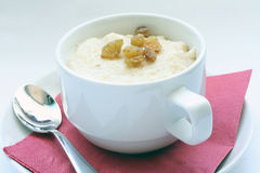 A cup of porridge. A cup of oatmeal porridge for the breakfast Stock Images