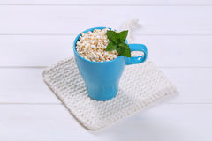 Cup of puffed buckwheat Royalty Free Stock Photo
