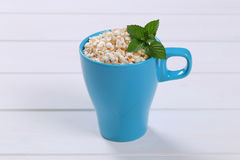 Cup of puffed buckwheat Royalty Free Stock Image