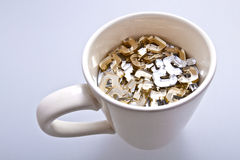 Cup of questions Stock Images
