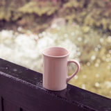 Cup in rainy day Stock Photo