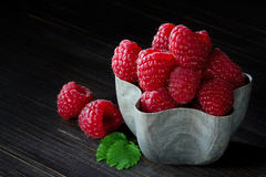 Cup of raspberries on dark background Royalty Free Stock Photography