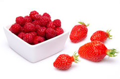 A cup of raspberries with strawberries Royalty Free Stock Photography