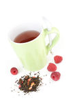 Cup of raspberry green tea. With fresh fruit Stock Photo