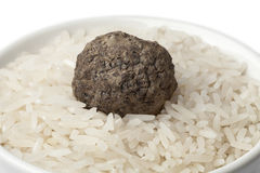 Cup of raw rice with black winter truffle Stock Photos