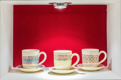 Cup in red showcase Stock Image