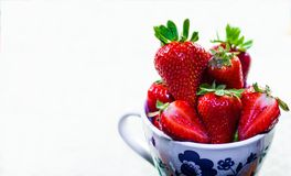 Cup of red strawberries for breakfast on white background. Eating red strawberries helps you live better by giving vitamins Royalty Free Stock Photography
