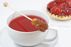 Cup of red tea. With jelly filled cake Royalty Free Stock Photography