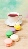 Cup of red tea and colored cakes Stock Images