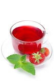 Cup of red tea with fresh strawberries and mint isolated Royalty Free Stock Photo