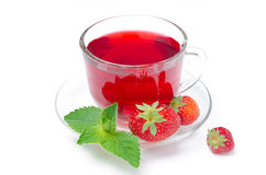 Cup of red tea with fresh strawberries and mint isolated Royalty Free Stock Photos