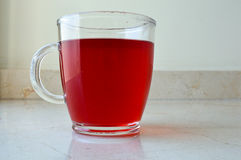 Cup of Red Tea. A Glass Cup of Red Tea Royalty Free Stock Image