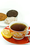 A cup of red tea with mixed cookies Royalty Free Stock Image