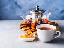 Teapot of red tea and honey Royalty Free Stock Images