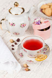 Cup of red tea on serving table Royalty Free Stock Image
