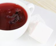 Cup of Red Tea and Sweets Stock Image