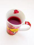 Cup of red tea on white Royalty Free Stock Photography