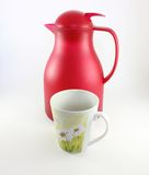 A cup and a red thermos Royalty Free Stock Photos