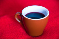Cup and red wine Stock Images