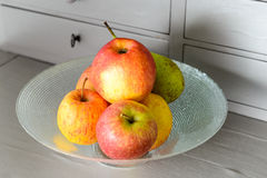 Cup with red and yellow apples Royalty Free Stock Image
