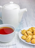A cup of redbush tea with tiny shortbread cookies. A cup of  tea with tiny shortbread cookies Royalty Free Stock Images