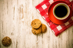 Cup of refreshing coffee. Cup of coffee and cookies on rustic wooden table Stock Photos
