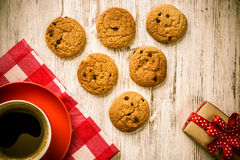Cup of refreshing coffee. Cup of coffee and cookies on rustic wooden table Royalty Free Stock Photos