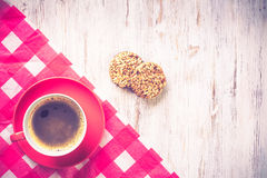 Cup of refreshing coffee. Cup of coffee and cookies on rustic wooden table Royalty Free Stock Image