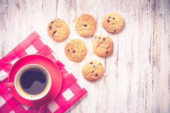 Cup of refreshing coffee. Cup of coffee and cookies on rustic wooden table Royalty Free Stock Images