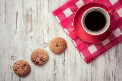 Cup of refreshing coffee. Cup of coffee and cookies on rustic wooden table Stock Photo