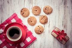 Cup of refreshing coffee. Cup of coffee and cookies on rustic wooden table Stock Photography
