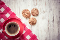 Cup of refreshing coffee. Cup of coffee and cookies on rustic wooden table Stock Image