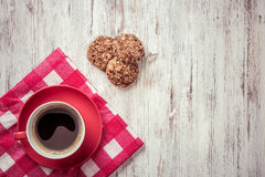 Cup of refreshing coffee. Cup of coffee and cookies on rustic wooden table Royalty Free Stock Photography