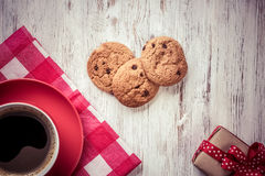 Cup of refreshing coffee. Cup of coffee and cookies on rustic wooden table Royalty Free Stock Photo