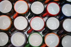 Cup Rims. Colorful handmade cups for sale at the outdoor craft market in Otavalo, Ecuador Stock Photo