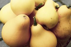 Cup of ripe yellow pears stock photography
