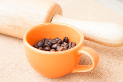 Cup of roast coffee bean and roller Royalty Free Stock Image