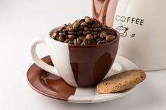 Cup of roasted brown coffee beans. On white background in coffee cup wilt coffee pot stock photo