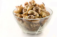 Cup of Roasted cashew nuts. Picture of healthy roasted cashew in a clear cup Stock Images