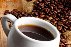 Cup and roasted coffee beans Stock Photography